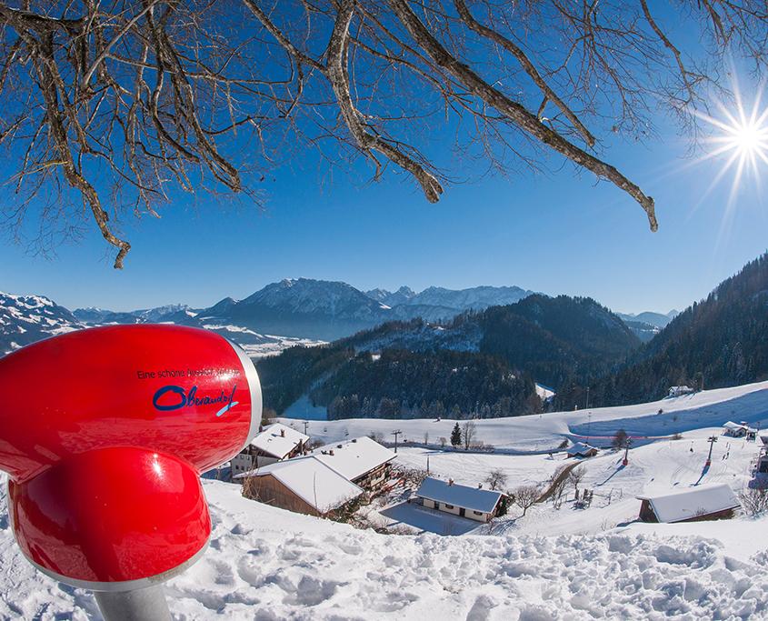 Fernsichgerät am verschneiten Gipfel des Hocheck in Oberaudorf